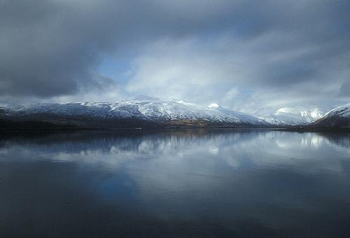 The play of light and clouds creates an eerie effect over Womens Bay on Kodiak Island in the Alaska Maritime National Wildlife Refuge. (John Martin/USFWS)